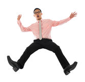 Asian businessman falling backwards Royalty Free Stock Photography
