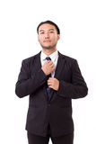 Asian businessman fastening his necktie Royalty Free Stock Photo