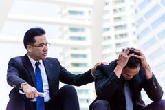 Asian Businessman feel sad and frustrated upset fail in life. The asian Businessman feel sad and frustrated upset fail in life Royalty Free Stock Photo