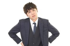 Tired Asian businessman. Asian businessman is feeling tired and stressed royalty free stock photo