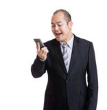 Asian businessman get angry to mobile Royalty Free Stock Image