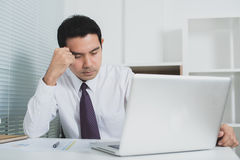 Asian businessman getting stressed at work Royalty Free Stock Photography
