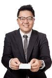 Asian businessman give a white card with both hand Stock Image