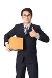 Asian businessman giving and carrying parcel, cardboard box, giv Stock Photography