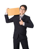 Asian businessman giving and carrying parcel, cardboard box, giv Royalty Free Stock Image