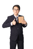 Asian businessman giving and carrying parcel, cardboard box, giv Royalty Free Stock Photo