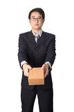 Asian businessman giving and carrying parcel, cardboard box, iso Stock Image