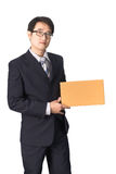 Asian businessman giving and carrying parcel, cardboard box, iso Stock Photo