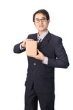 Asian businessman giving and carrying parcel, cardboard box, iso Royalty Free Stock Image