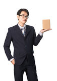 Asian businessman giving and carrying parcel, cardboard box, iso Stock Photography