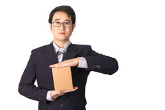 Asian businessman giving and carrying parcel, cardboard box, iso Royalty Free Stock Photos