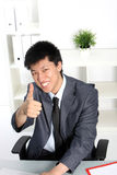 Asian businessman giving a thumbs up Stock Photography