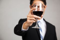 Asian businessman with glass of red wine focus at glass Stock Photography