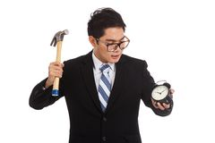 Asian businessman with hammer and alarm clock Royalty Free Stock Image