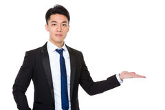 Asian businessman with hand showing something Stock Photography