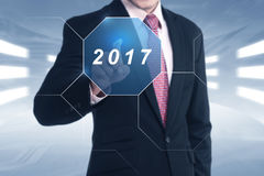 Asian businessman hand touched 2017 Stock Photography