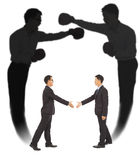 Asian businessman handshake with fighting shadow Stock Photography