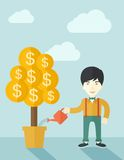 Asian businessman happily watering the money tree Stock Photo