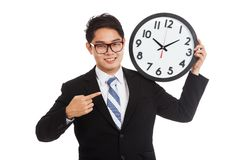 Asian businessman happy point to a clock Royalty Free Stock Image