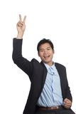 Asian businessman happy show victory sign over his head Stock Photos
