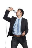 Asian businessman happy sing a song. Isolated on white background royalty free stock images