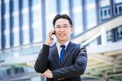 Asian businessman has working on mobile with happy. The asian businessman has working on mobile with happy Stock Photography
