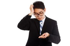 Asian businessman headache with medicine in his hand royalty free stock photo