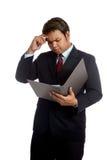 Asian businessman  headache read data in a report Royalty Free Stock Photos