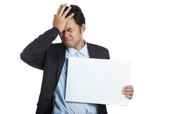 Asian businessman headache show  blank sign Royalty Free Stock Photo