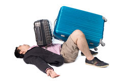 Asian businessman with heavy travel bag. Isolated on white background Stock Images