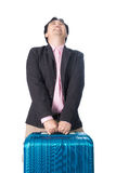 Asian businessman with heavy travel bag Stock Photo