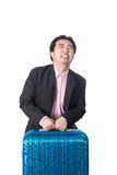 Asian businessman with heavy travel bag Royalty Free Stock Images