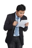 Asian businessman hesitate to speak look at a paper Royalty Free Stock Image