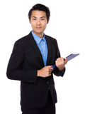 Asian businessman hold with clipboard Royalty Free Stock Images