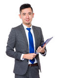 Asian Businessman hold with clipboard Stock Photo