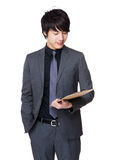Asian businessman hold with clipboard Royalty Free Stock Image