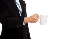Asian businessman hold a cup of coffee Royalty Free Stock Photo