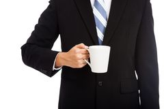Asian businessman hold a cup of coffee Royalty Free Stock Photography
