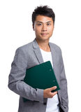 Asian businessman hold with file pad Royalty Free Stock Photo