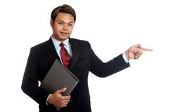 Asian businessman hold a folder point to his side look at camera Stock Photos