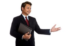 Asian businessman hold a folder talking to someone Stock Images