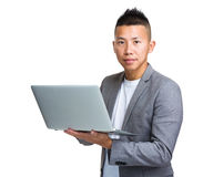 Asian businessman hold laptop Stock Image