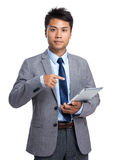 Asian businessman hold with tablet pc Stock Photo