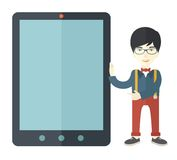 Asian businessman holding a big screen tablet Royalty Free Stock Photography
