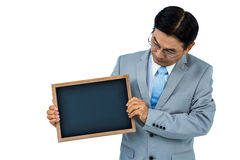 Asian businessman holding a black board Stock Images