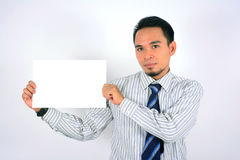 Asian businessman holding blank paper isolated on white. Asian businessman holding blank paper Stock Photo