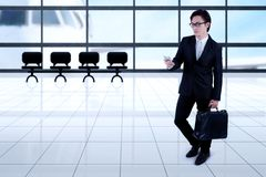 Asian businessman with smartphone in the airport Stock Photography