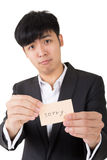 Sorry word. Asian businessman holding a card written on sorry, closeup portrait royalty free stock images