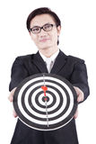 Asian businessman holding dartboard. On white background Royalty Free Stock Images