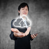 Asian businessman holding digital cloud computing icon, business concpept Royalty Free Stock Images